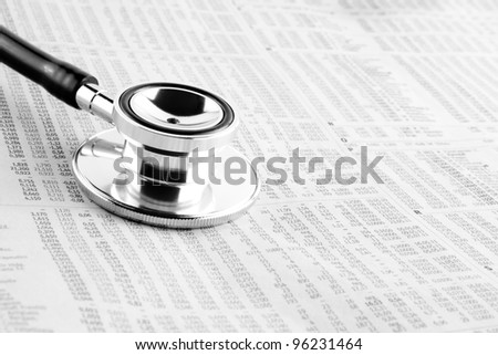 detail of a stethoscope on financial newspaper - stock photo