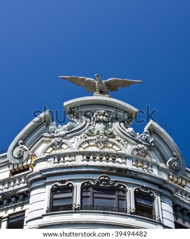 Detail of a stone eagle and windows in a building - stock photo