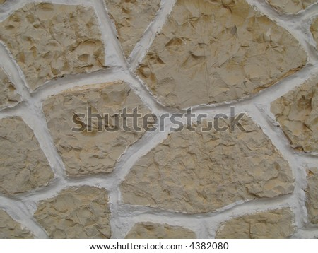 Detail of a stone wall with a giraffe pattern