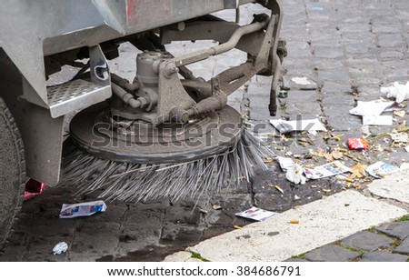 detail of a street sweeper machine/car cleaning a road in Rome - stock photo