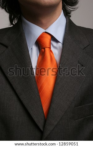 Detail of a suit and a tie - isolated in soft light - stock photo
