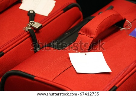 Detail of a suitcase with a blank tag - stock photo
