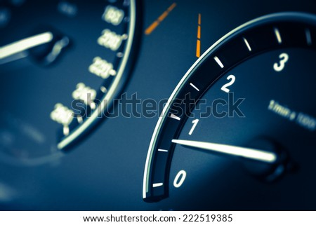 Detail of a tachometer in a car. - stock photo