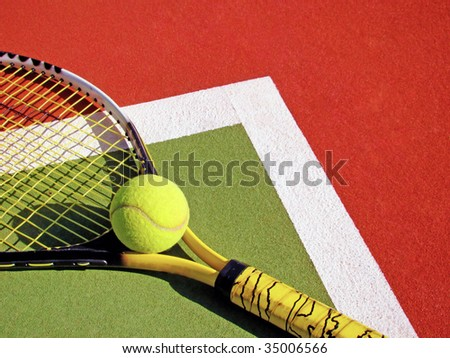 detail of a tennis court with ball and racket - stock photo