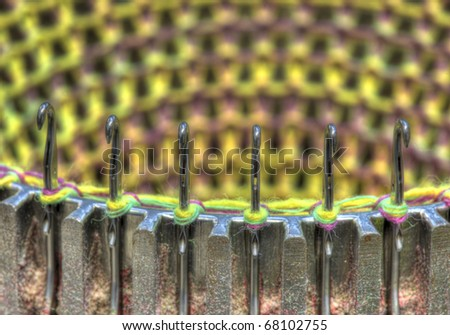 Detail of a three dimensional knitting machine - stock photo