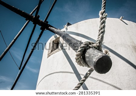 Detail of a traditional Portuguese windmill against a blue sky - stock photo