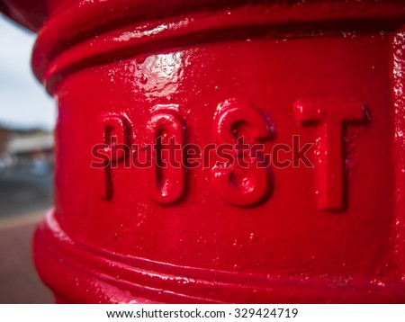 Detail Of A Traditional Red British Royal Mail Post Box - stock photo