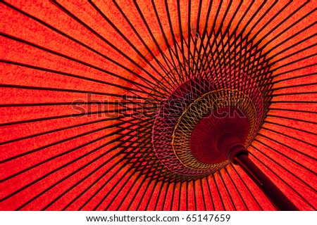 Detail of a traditional red japanese umbrella - stock photo