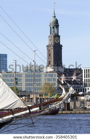 Detail of a traditional sailing vessel, church tower of the Michel in Hamburg, Germany - stock photo