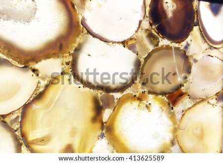 Detail of a translucent slice of natural stone agate. Natural patterns and textures of minerals for background. Natural stone agate surfaces, backgrounds and wallpapers. Seamless abstract background.