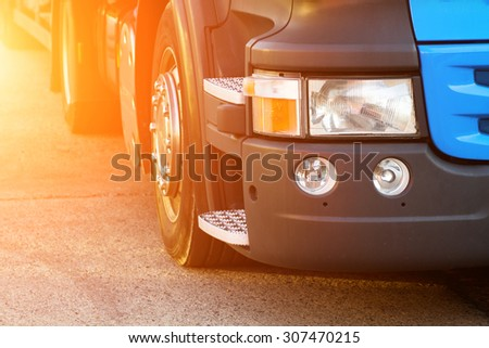 detail of a truck on the road at sunset - stock photo