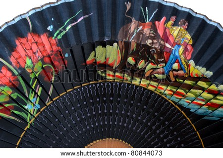 Detail of a typical spanish fan over white background - stock photo