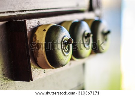 detail of a very old light switch  - stock photo