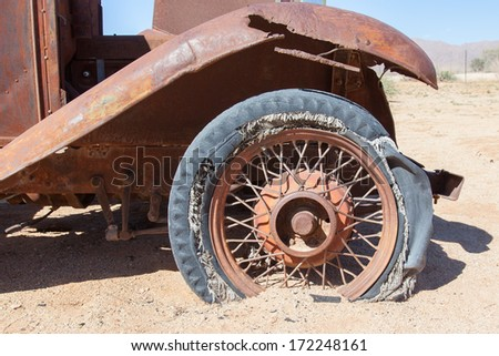 Detail of a vintage abandoned flat car tire on the side of a road, Namibia - stock photo