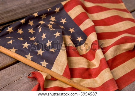 detail of a vintage American flag on a wood table - stock photo