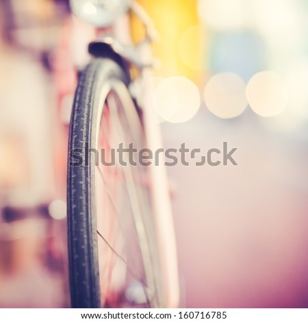 Detail of a Vintage Bike Tire with Colorful Background Bokeh (shallow DOF) - stock photo
