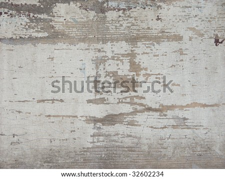 Detail of a vintage door with flaking white paint - stock photo