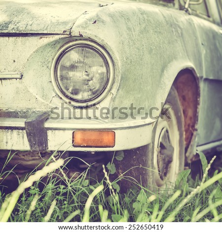 Detail of a Vintage Rusty Car Headlight - stock photo