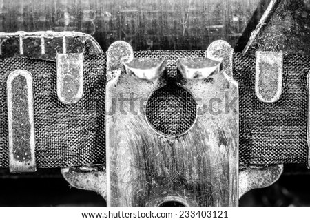 detail of a vintage typewriter in black and white - stock photo