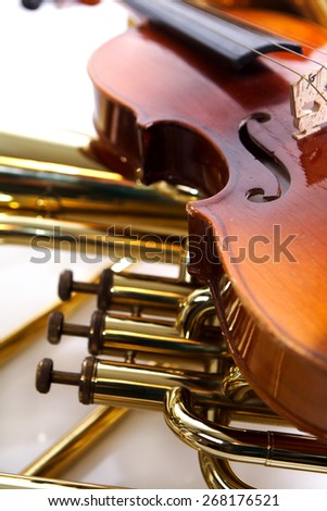 Detail of a violin and a trombone - stock photo
