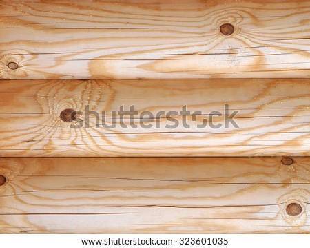 Detail of a Wall of a Wooden House Built From Fresh Pine Logs - stock photo