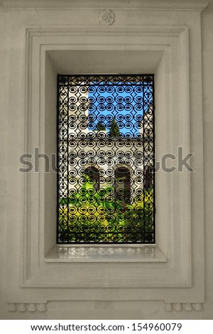 Detail of a wall with a window overlooking the courtyard - stock photo