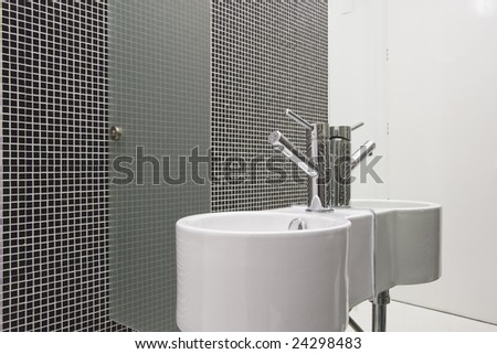 Detail of a washbasin at a bathroom with mirror - stock photo