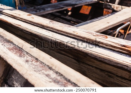 detail of a weathered wooden small boat - stock photo