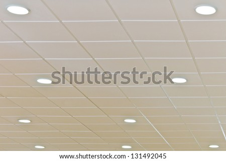 Detail of a white ceiling with integrated lightning - stock photo
