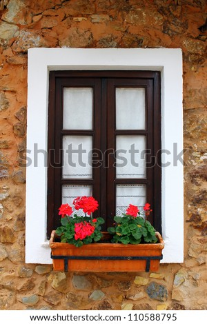 Detail of a window in a little portuguese village - stock photo