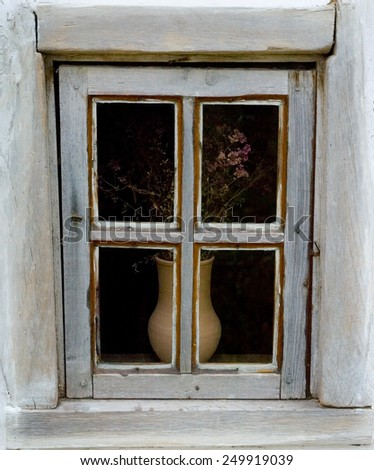 Detail of a window of a typical ukrainian antique house, in Pirogovo near Kiev - stock photo
