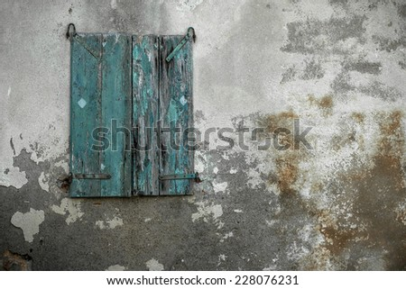 Detail of a window on old house. - stock photo