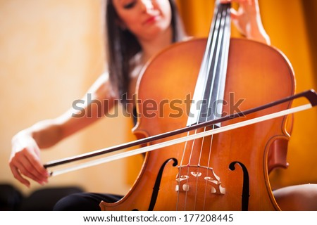 Detail of a woman playing a cello - stock photo