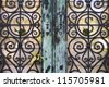 Detail of a wrought iron door in a cemetery - stock photo