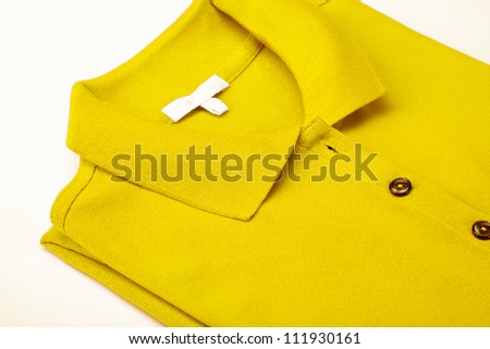 Detail of a yellow polo shirt. - stock photo