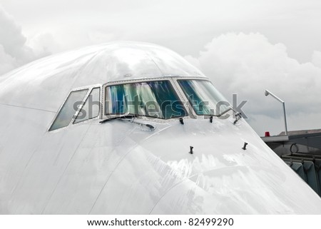 detail of aircraft nose with cockpit window - stock photo
