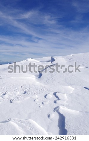 Detail of alpine snowy slope in winter. - stock photo