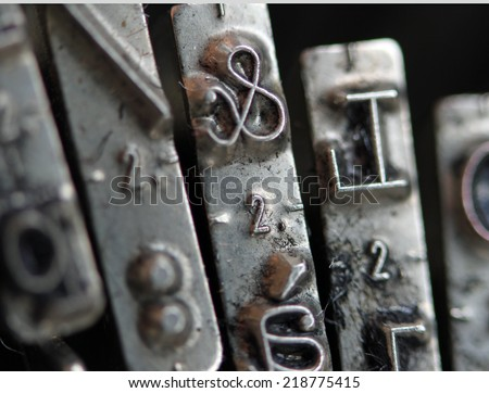 Detail of ampersand key in a very old mechanical typewriter - stock photo