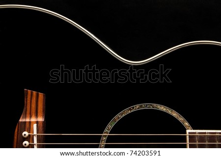 Detail of an acoustic black guitar - stock photo