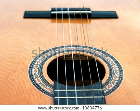 Detail of an acoustic guitar - stock photo