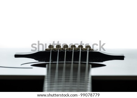 Detail of an acoustic guitar with a shallow depth of field