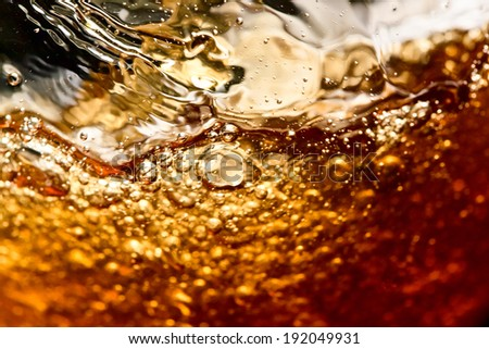 detail of an alcoholic beverage on black background - stock photo