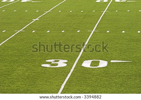 Detail of an American football field - 30 yard line. - stock photo