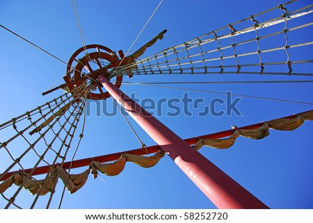 Detail of an ancient ship mast with rope ladder and surveillance basket - stock photo