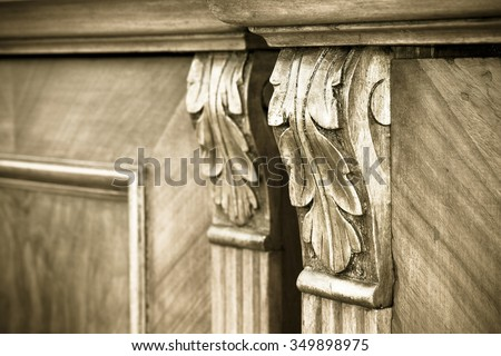 Detail of an antique italian furniture just restored - stock photo