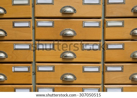 Detail of an apothecary cabinet with empty and blank labels - stock photo