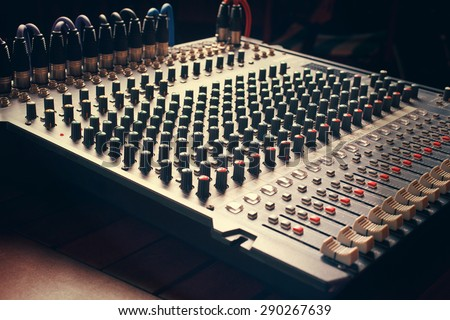 detail of an audio mixer board - stock photo