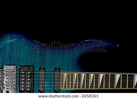 Detail of an electric guitar isolated on black - stock photo