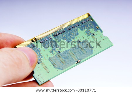 Detail of an electronic circuit board being held - stock photo