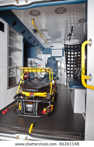 Detail of an empty ambulance interior with stretcher - stock photo
